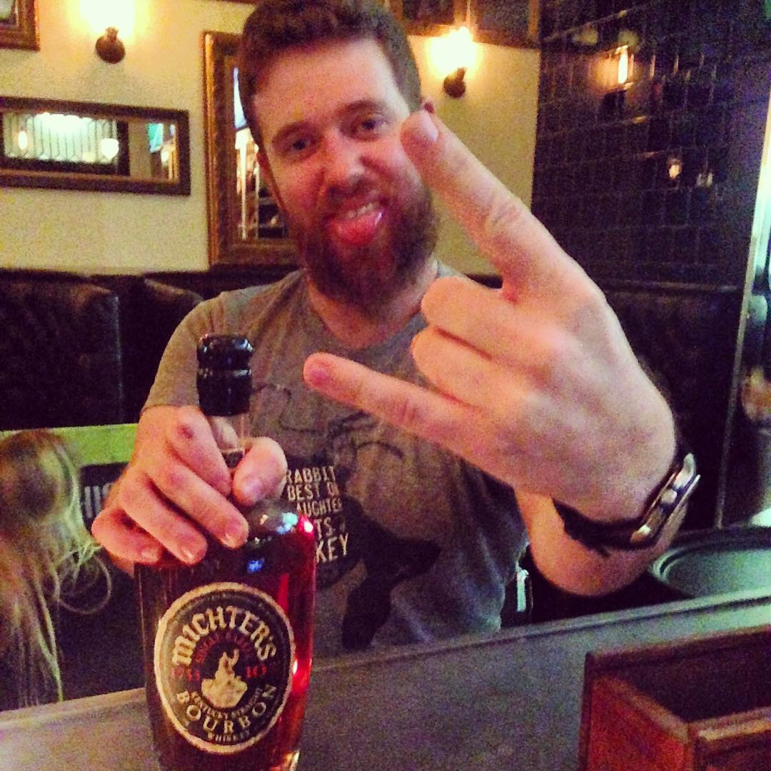 When @ian.the.whiskeyginger wearing his @deadrabbitnyc shirt gets stoked about the @michterswhiskey and throws up dem horns! #bourbon #whiskey #glencairn #cocktailbar #whiskeyneat #michters10 #statecollegepa #glencairn #rockstar