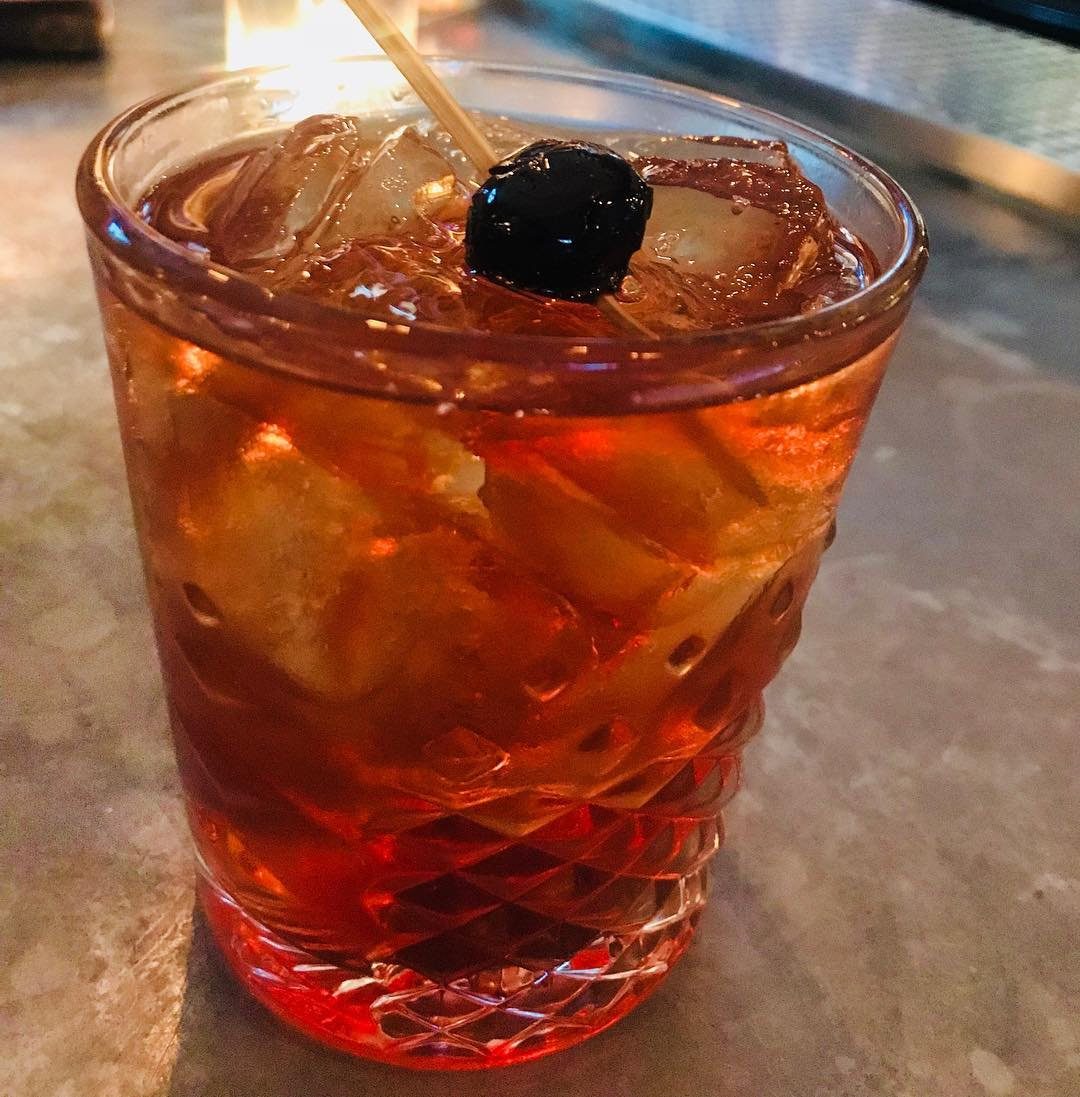 Manhattan up or on the rocks, what's your preference? Let us know! : Our House Manhattan is made with Rittenhouse Rye, Cocchi Torino Vermouth, and the ever iconic @angosturaaromaticbitters. And of course a Manhattan wouldn't be complete without a deliciou